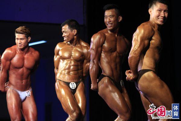 缅甸举办健美大赛 肌肉男模特女大秀好身材